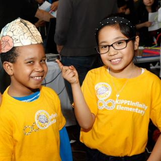 Students wearing a brain hat, enjoying learning about the brain at the 2016 Brain Expo
