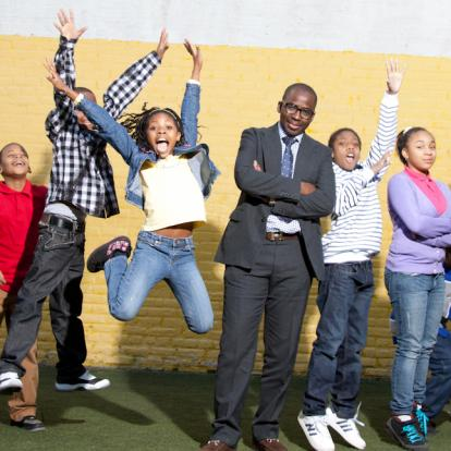 Olajide Williams, MD with a group of energetic and excited kids
