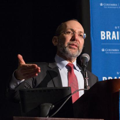 jonathan weiner speaks at recent brain insight lecture in front of blue background