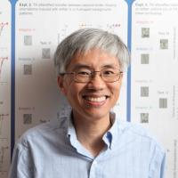 Ning Qian, PhD in front of scientific poster