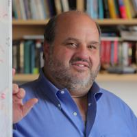 Daniel Salzman in front of bookshelf