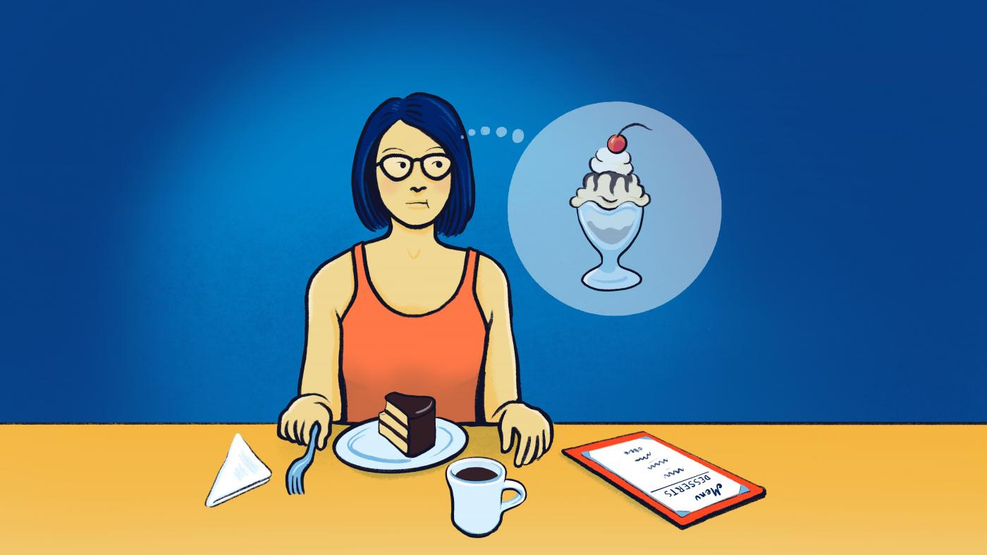 A woman at a restaurant eating a cake while regretfully thinking of the sundae she wish she ordered instead.