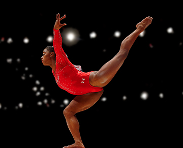 Olympic gymnast Simone Biles tumbling on beam